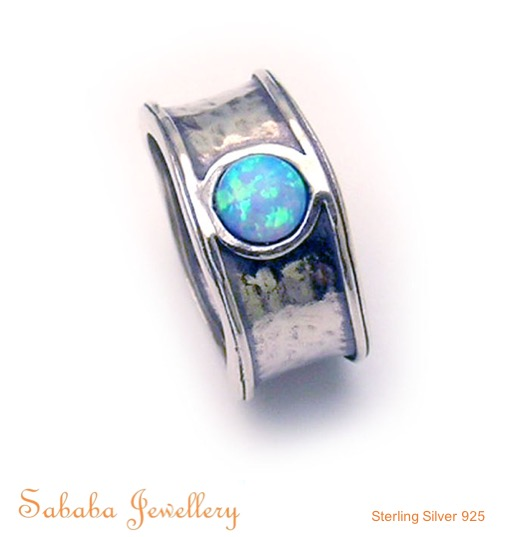 Sold Silver Ring with solitaire feature.